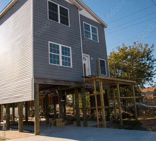 House being raised and put on stilts to avoid flooding in this New Jersey shore Fototapeta