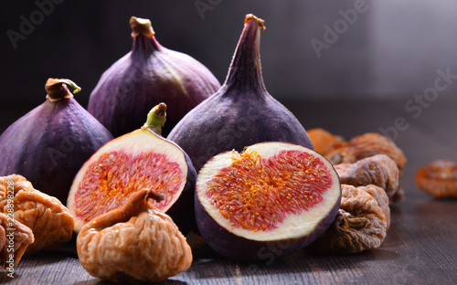 Composition with fresh and dried figs on wooden table