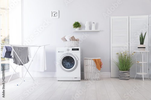 Laundry room interior with washing machine near wall Canvas-taulu