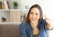 Happy Homeowner Gesturing Thumbs Up