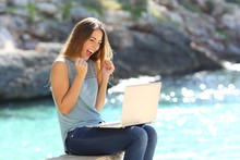 Excited Woman Finding Online Offer On The Beach