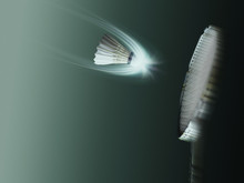 Badminton Racket And Shuttlecock In Action