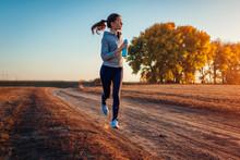 Woman Running In Autumn Field ...