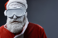 Close Up Portrait Of Bearded Old Man In Santa Costume Covered With Snow. Copy Space On Right Side