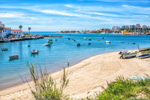 View On The Ferragudo And Portimao Algarve Across The River And Many Fishing Boats In The Foreground