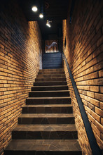 Staircase In Old Cellar With Brick Walls. Loft Staircase With Brick Walls