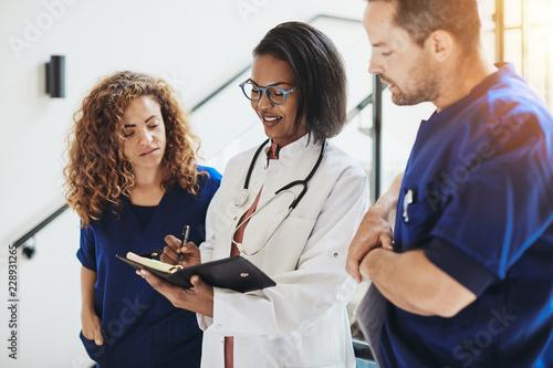 Fotografía  Group of diverse doctors talking together in a hospital corridor