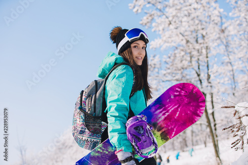 plakat Leisure, winter, sport concept - person snowboarder going up with board