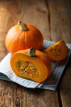 Ripe Pumpkin On Wooden Desk