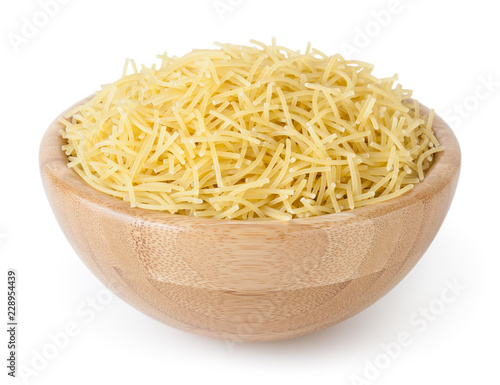Cuadros en Lienzo Uncooked vermicelli pasta in wooden bowl isolated on white background with clipp