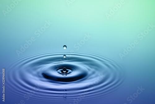 Water splash - falling drop of rain