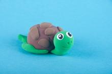 Funny Toy Turtle On Blue Backg...