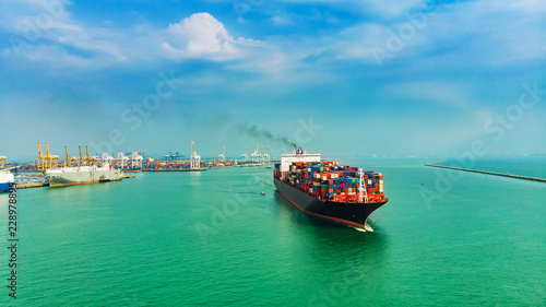 Valokuva  Logistics and transportation of Container Cargo ship and Cargo import/export and