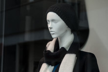 Closeup Of Mannequin With Winter Hat In Fashion Store Showroom