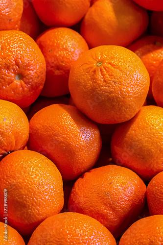 Fotografie, Obraz  set of citrus orange mandarins vertical pattern closeup fruit base source of vit