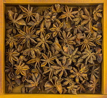 Colorful Background Dry Starry Anise Crumple In A Wooden Lot Of Spices In A Wooden Frame Base