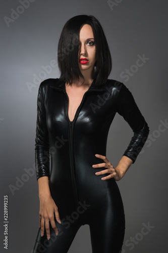 woman in latex suit on a dark background Fototapeta