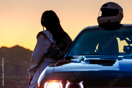 Wall Murals F1 A Female Race Car Driver Watching The Sunrise Before Taking To The Track