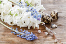 White Hyacinth And Blue Muscari Flowers On Wood