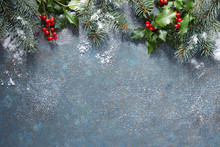 Christmas Background With Fir Tree And Holly Berry, Covered In Snow, With Copy Space.