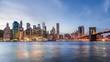 4k cinemagraph of New York City Manhattan, financial district night skyline, cityscape at Brooklyn bridge park during sunset, dusk, twilight, blue hour, skyscrapers, moving cars, light streaks