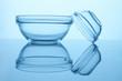 Leinwanddruck Bild - Bowls with blue glasses isolated on white background. Close up. Reflective surface.
