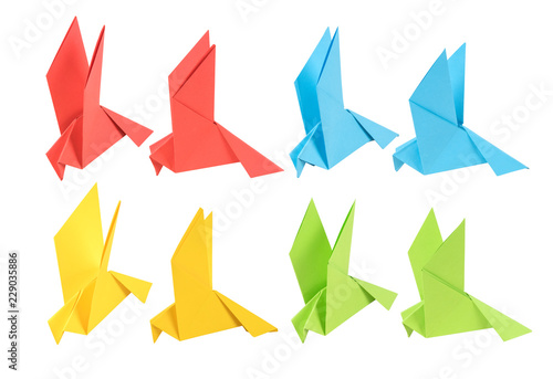 set of origami in the form of a dove of four colors in two angles