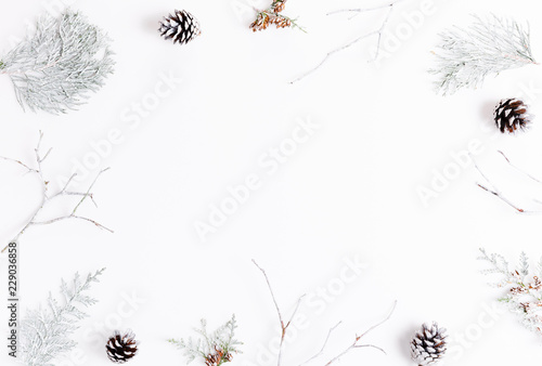 Minimalist Christmas composition in bright colors made of pine branches on white background. Christmas, winter, new year concept. Flat lay, top view, copy space