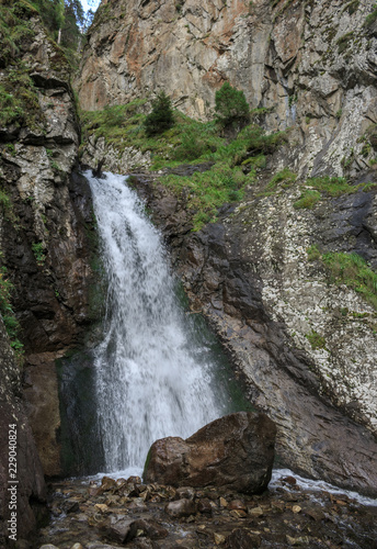 Keuken foto achterwand Watervallen Closeup view waterfall scenes in mountains, national park Dombai, Caucasus, Russia, Europe. Summer landscape, sunshine weather and sunny day
