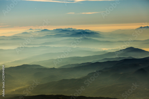 early morning Haze in the mountains - aerial view - peaks are looking out