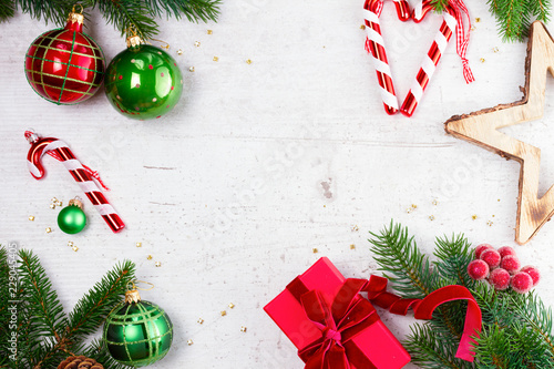 Foto op Plexiglas Tulp Christmas gift giving flat lay frame - christmas present in red box and decorations on white wooden table with copy space