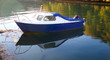 Small boat on the reflective river
