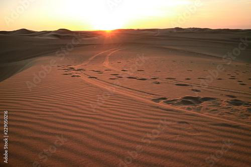 Poster de jardin Desert de sable The sun setting over the sand dune of Huacachina desert, Ica region, Peru, South America