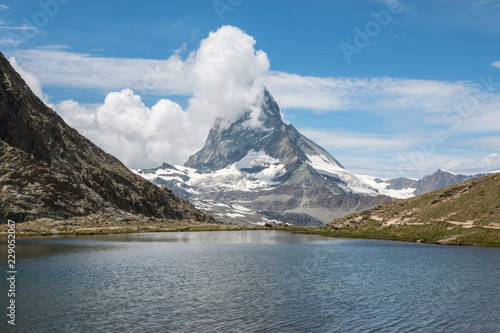 In de dag Bergen View closeup Riffelsee lake and Matterhorn mountain, scenes in national park Zermatt, Switzerland, Europe. Summer landscape, sunshine weather, dramatic blue sky and sunny day
