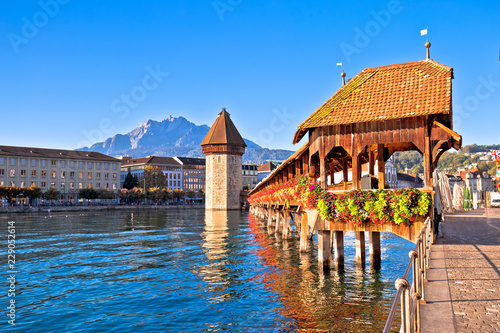 Fotografie, Obraz Kapellbrucke historic wooden bridge in Luzern and waterfront landmarks view