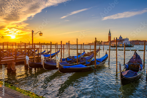 Sunrise in San Marco square, Venice, Italy. Architecture and landmarks of Venice. Venice postcard with Venice gondolas