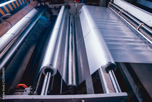 Obraz Modern automated production line in factory. Plastic bag manufacturing process - fototapety do salonu