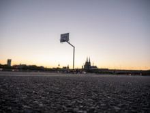 Urban Basketball Hoop With Skyline Of Cologne, Germany, In Background