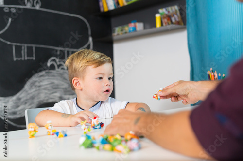 Vászonkép  Cute little playfull toddler boy at child therapy session