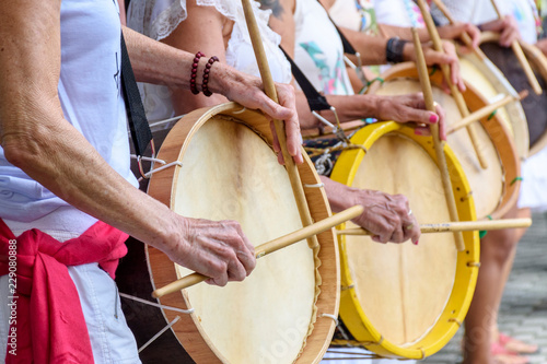 Fotografie, Obraz Womans percussionists playing drums during folk samba performance on Belo Horizo