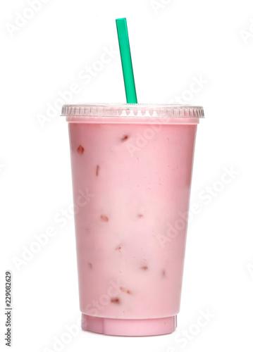 Fototapeta Strawberry or raspberry milkshake smoothie in take away cup isolated on white ba