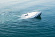 canvas print picture - Sinking modern large white boat goes underwater