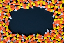 Halloween Candy Corn Scattered On A Black Background With An Open Space In The Middle