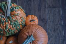 4 Orange Pumpkins With A Green...