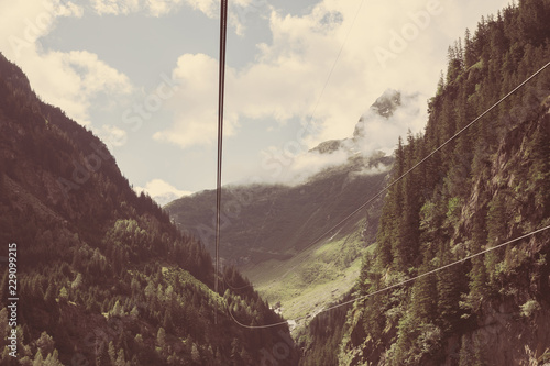 Fotobehang Landschap Closeup mountains scenes, cable car to Trift Bridge in national park Switzerland, Europe. Summer landscape, sunshine weather, cloudy sky and sunny day
