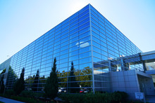 Close Up On Modern Company Building Exterior With Blue Glass