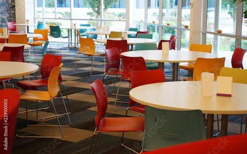 tables and chairs in the cafeteria of the company Fototapet