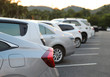Closeup of rear side of silver car park in parking area in the evening.