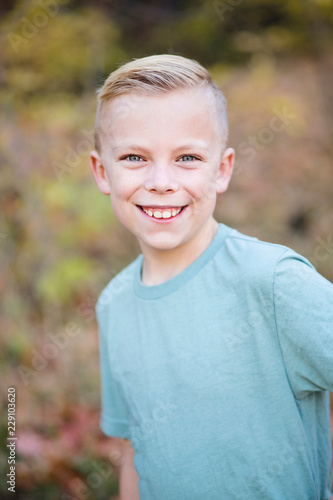 A Portrait Of A Handsome 10 Year Old Boy Playing Outdoors With A Big