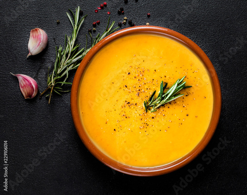 Tablou Canvas Pumpkin and carrot  Cream soup on  black board  background